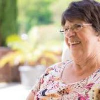 Older woman showing Attitude of Gratitude by smiling