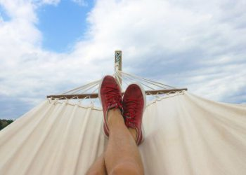 view of feet in hammock to illustrate vacation during covid-19